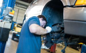 Holtzman Oil Corp. servicing personnel working on a customer car