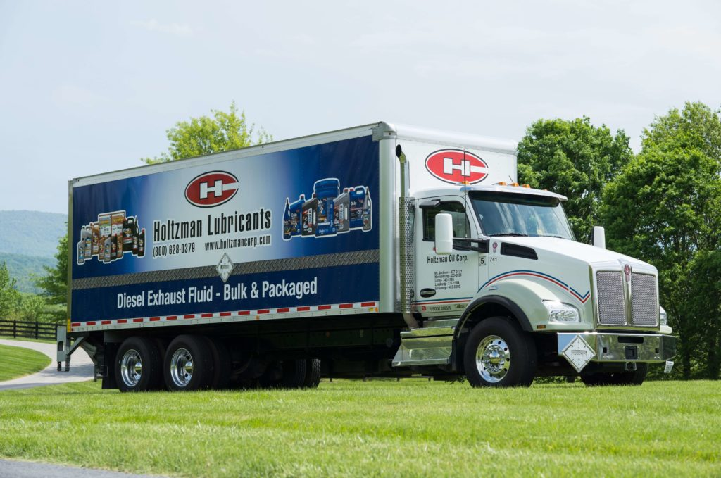 Holtzman DEF lubricants transport truck in a field