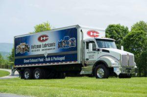 Holtzman DEF lubricants transport truck in a field