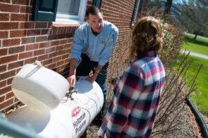 Holtzman Propane employee helping a customer with their propane tank