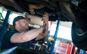 Holtzman employee working on servicing Holtzman Oil Corp. customer vehicle