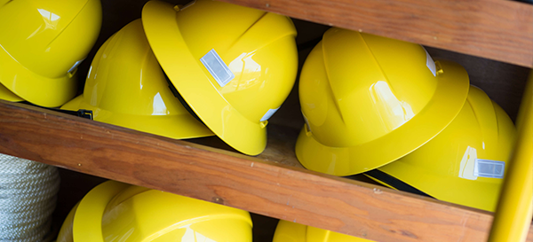 Hard hats on shelf at Holtzman Oil Corporation